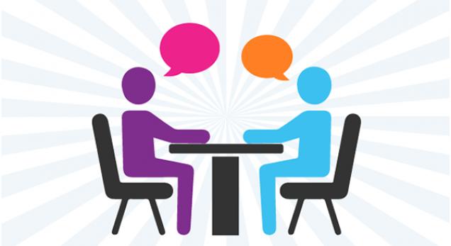 A képen két rajzolt alak látható, akik beszélgetnek egymással