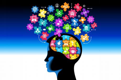 A képen egy emberi fej látható, számtalan emléket szimbolizáló mozaik-darabbal a fejében