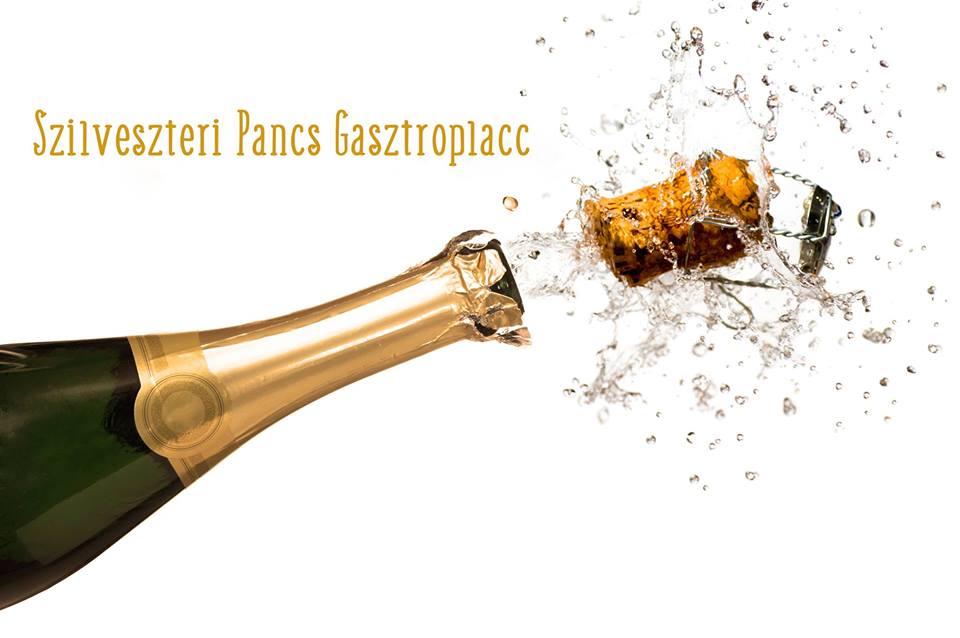 A képen egy pezsgősüvegből éppen kirobban a dugó, jelezve azt, hogy ez a rendezvény az ünneplés kezdete lehet