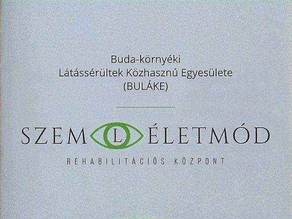 A képen a Szemléletmód rehabilitációs Központ szórólapjának a teteje látható, melyen a Szem és az Életmód szavak közötti L betű egy szembe van belerajzolva