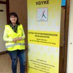 A képen Kis Erika szolgáltatási vezető áll a VGYKE roll up mellett